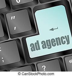 Advertising concept: computer keyboard with word Ad Agency, selected focus on enter button
