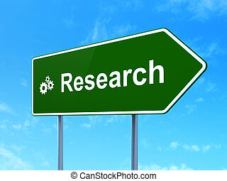 Advertising concept: Research and Gears on road sign ...