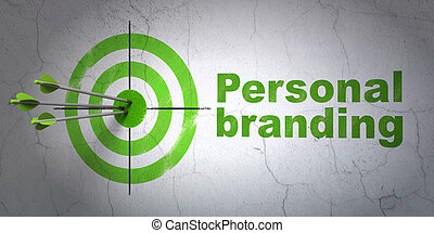 Advertising concept: target and Personal Branding on wall background