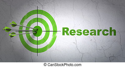 Advertising concept: target and Research on wall background...