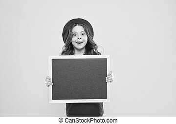 Advertising copy space. Back to school concept. Happy hours. Good news. School information. Informing you. Child promo information board. Place for information. Girl hold blank blackboard chalkboard