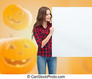 smiling teenage girl with white board
