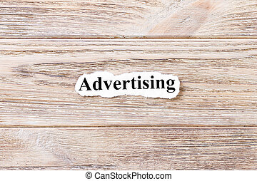 Advertising of the word on paper. concept. Words of Advertising on a wooden background