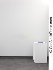 Advertising space, blank wall with a base inside a building