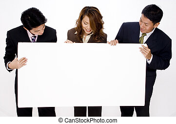 Advertising Space - Three young business people look at a ...