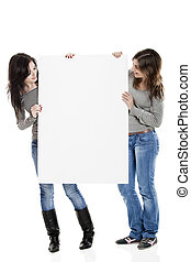 Advertising - Portrait of two beautiful young women holding...