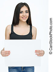 Young smiling woman show blank card or paper