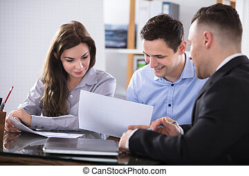 Advisor Discussing With Couple