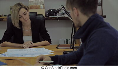 Advisor on Finance and Taxation, a woman in a modern office.
