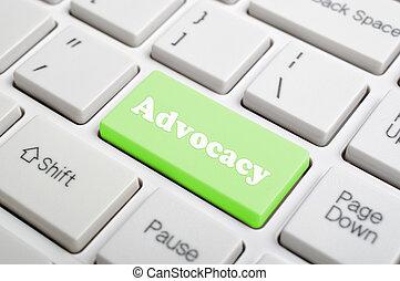 Advocacy key on keyboard - Green advocacy key on keyboard