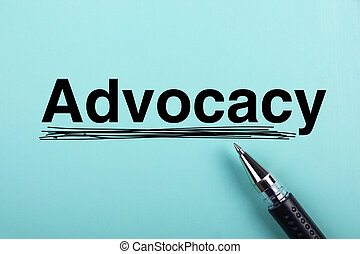 Advocacy text is on blue paper with black ball-point pen...