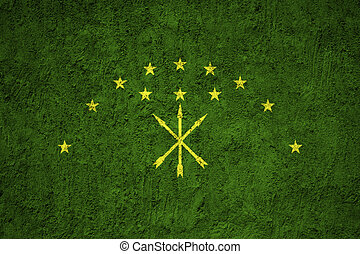 Adygea flag painted on the cracked grunge concrete wall