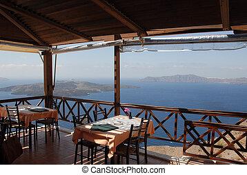 Restaurant overlooking the Aegean in Santorini, Greece