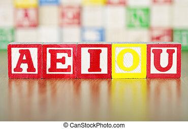 AEIOU Spelled Out in Alphabet Building Blocks