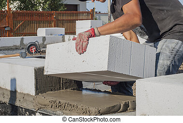 aerated concrete masonry - builder puts on grout aerated...