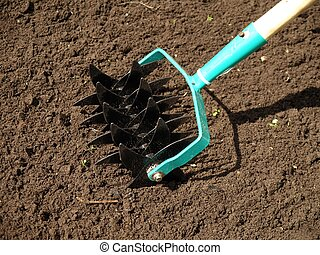 Aerator - Garden work: cultivation of soil, close up