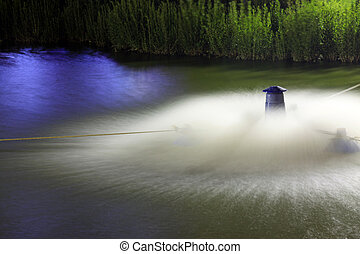 aerator in the pond, closeup of photo