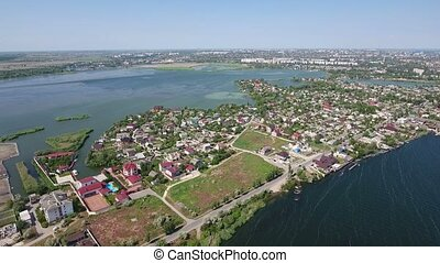 Aeriaal shot of the Dnipro river banks with some private houses  in spring