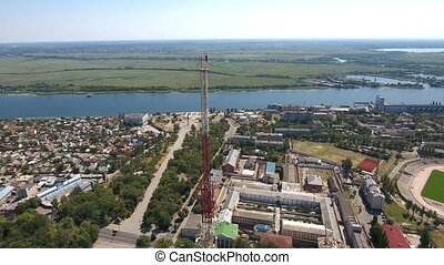 Aerial 180 degree shot of a TV tower on the Dnipro bank with...