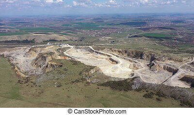 Aerial 4k drone view of a limestone quarry, open pit mine, mining industry