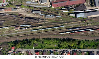 Aerial 4k drone view of old locomotive train depot, parking...