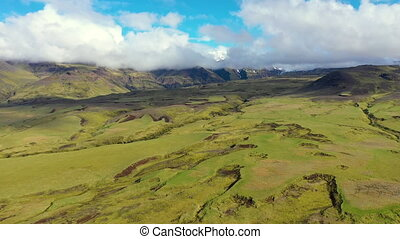 Aerial 4k drone view of the lava flows and green moss of Eyjafjallajokull volcano in Iceland