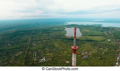 Aerial 4k footage from drone flying around radio telecommunication tv tower in suburb of Stavropol Russia