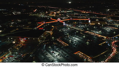 Aerial 4k night time lapse of shopping mall in Sheffield UK with Christmas lights