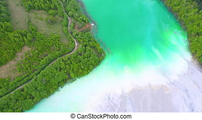 Aerial 4k view of a big waste decanting lake, tailing pond....