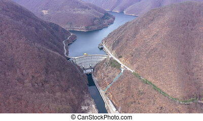 Aerial 4k view of a hydroelectric plant and dam, weir, lake...