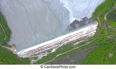Aerial 4k view of chemical mining waste residuals flooding...