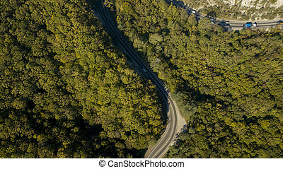 Aerial above view of a rural landscape with a curvy road running through it in Russia. Drone photography.