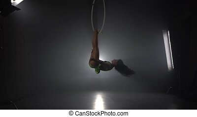 Aerial acrobat in the ring. A young girl performs the...