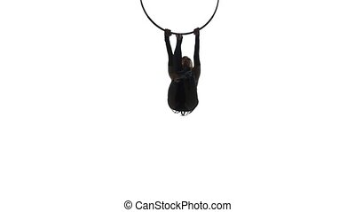 Aerial acrobat man on circus stage. Silhouette on a white...