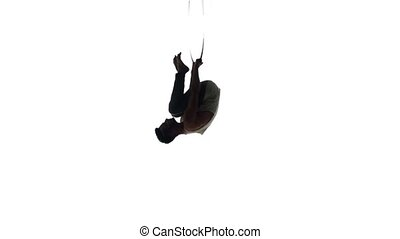 Aerial acrobat man on circus stage. Silhouette on a white background.