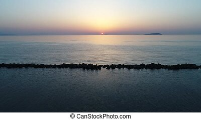 Aerial advance view of calm ocean at sunset - aerial drone ...