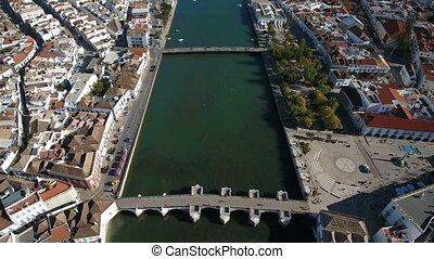 Aerial. Ancient Roman bridge over the river Gilao, the...