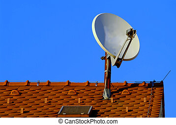 aerial antenna -  a white satellite dish on red roof