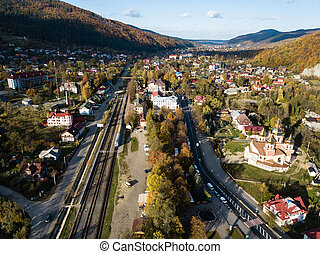 Aerial autumn top view of the Carpathian village at sunny day