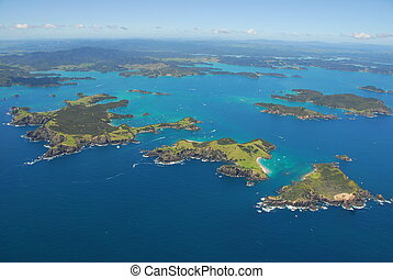 An aerial shot overlooking some of the 144 islands that are located in the Bay of Islands
