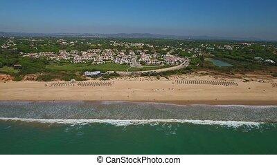 Aerial. Beach Garrao shores Vale de Lobo.