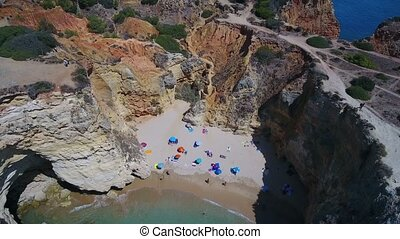 Aerial. Beaches and rocky shores of Portimao. Praia Joao...