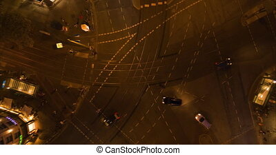 AERIAL: Beautiful Aerial Drone Time Lapse of Busy intersection at night in Berlin, Germany with city lights on Rosenthaler Platz