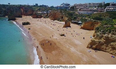 Aerial. Beautiful Portuguese beaches and shores of the city of Lagos. View from the sky, Algarve.