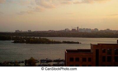 Aerial beautiful sunset view on Novosibirsk city and bridge....