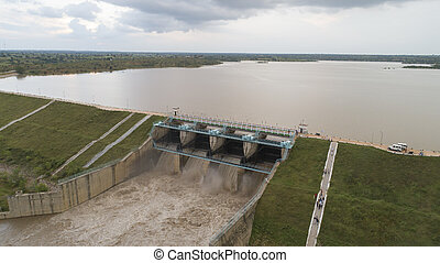 Aerial bird eye of water reservoir flood gates open to release water during monsoon flood from dam at raichur, India