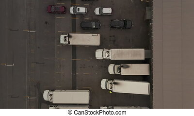 AERIAL: Birds Eye View of Cargo Truck loading area with crates and containers