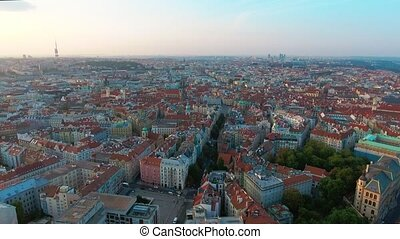 Aerial Birdseye flying low around Old Town Square, sunrise,...
