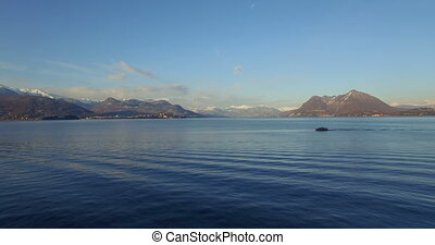 Aerial: Boat on Lago Maggiore lake