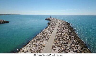 Aerial. Breakwater pier fishing port town Quarteira.